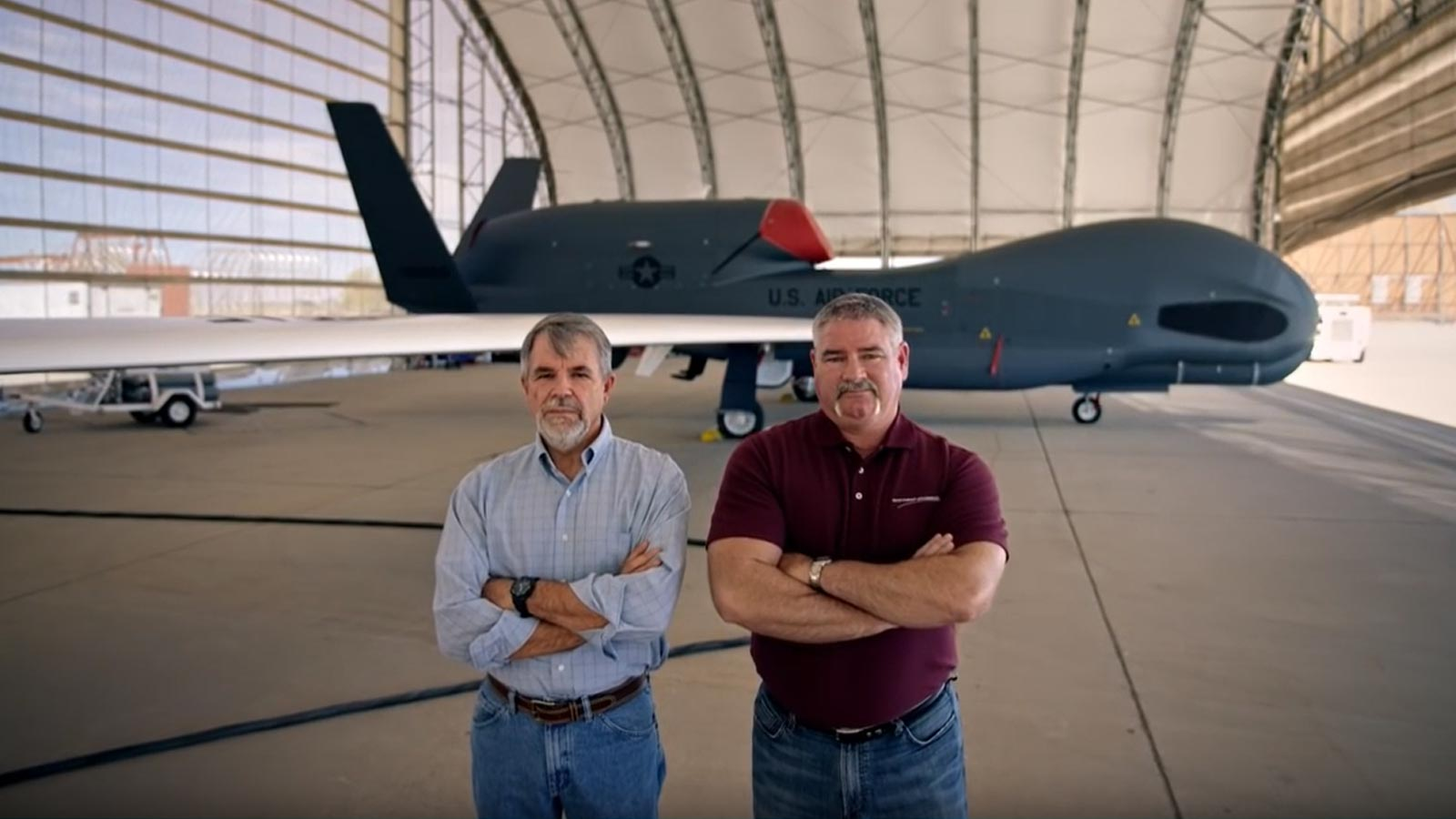 two men standing in front of unmanned aircraft