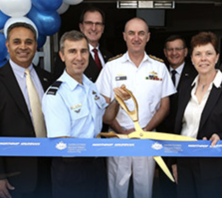 Five men and a woman at a ribbon-cutting ceremony