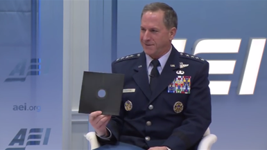 Gen. David L. Goldfein holds up a floppy disk to show need for nuclear triad modernization