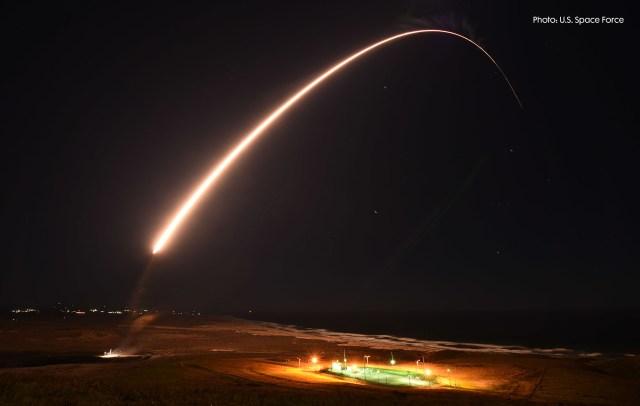 A missile followed by a streak launching in a dark sky