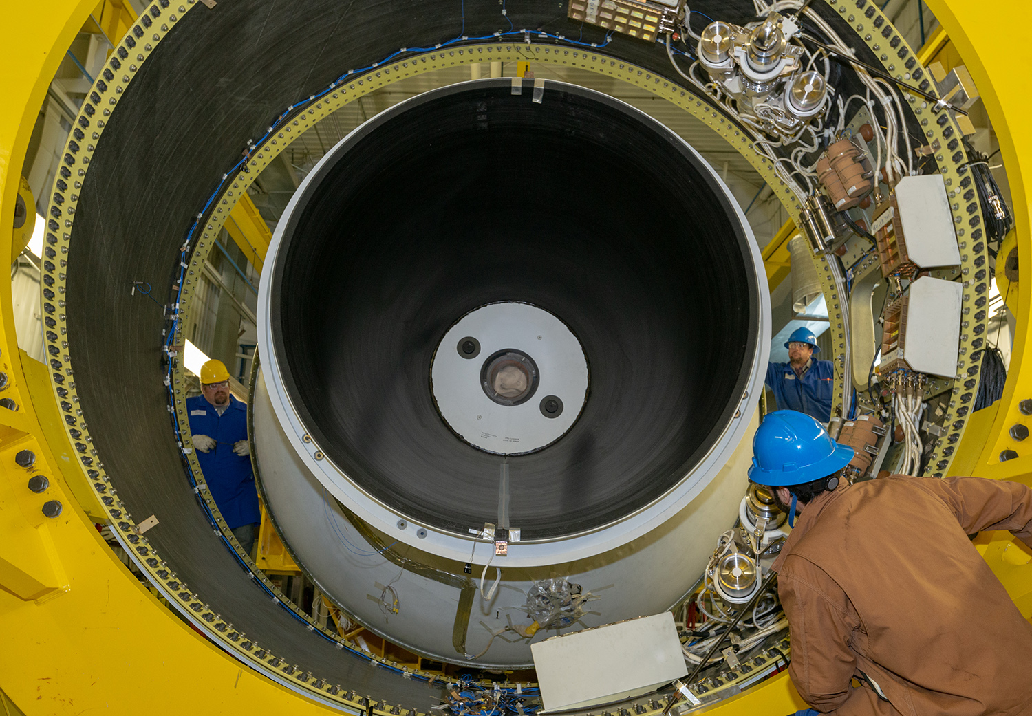 A Northrop Grumman engineer works on installing the aft skirt of the OmegA second stage in preparation for the static test in Promontory, Utah. (February 2020)