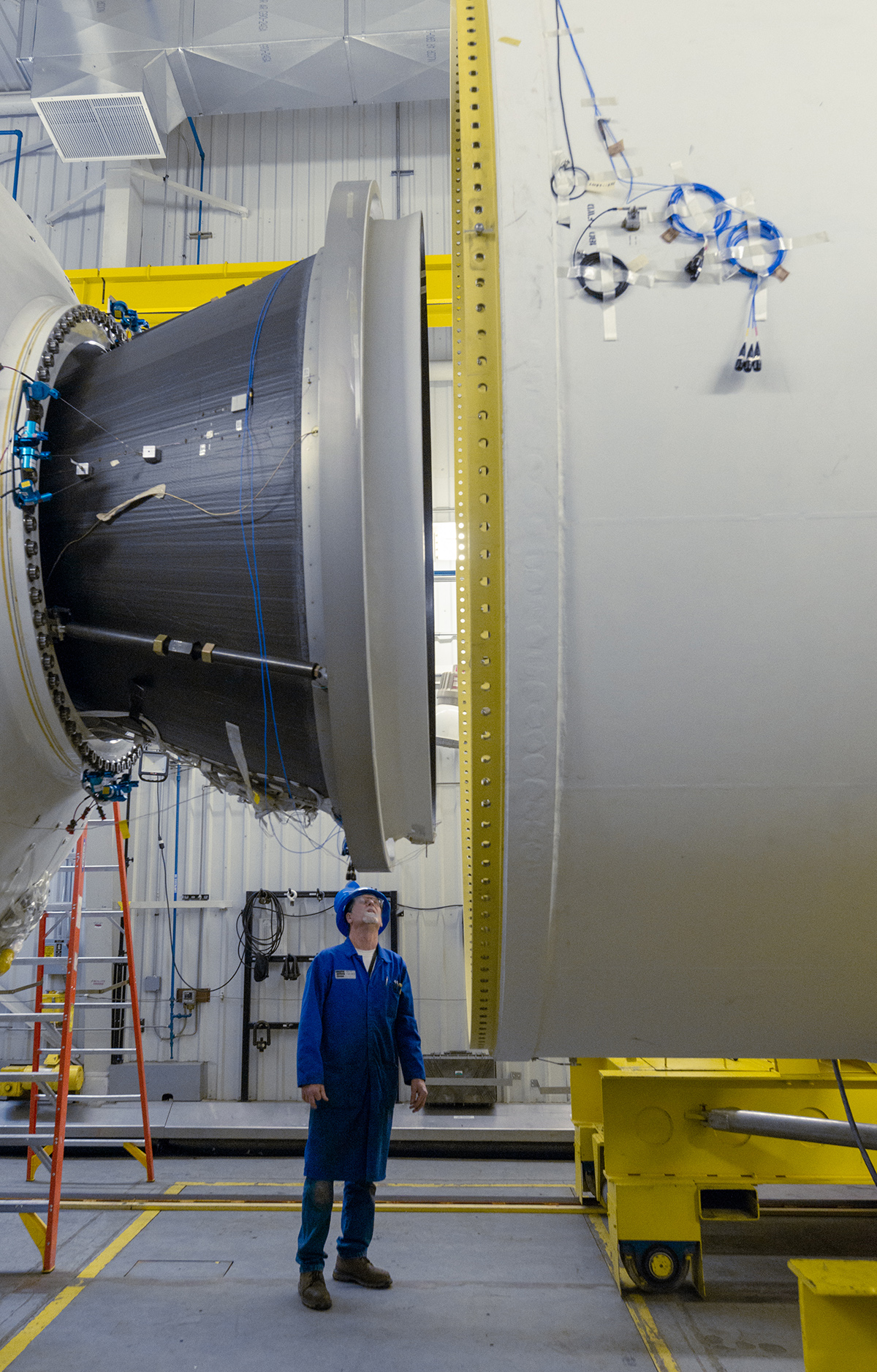Northrop Grumman engineers unite the forward end of the second stage with a space segment ahead of static fire. (January 2020)