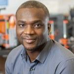 black man smiling in a lab