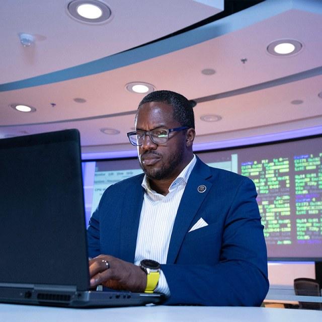 black male digital design engineer using laptop