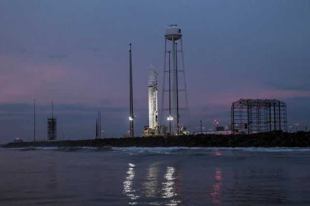Rocket on launch pad at dawn