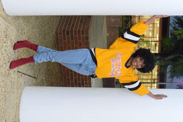 African american female posing between columns