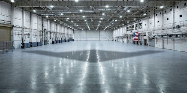 shadow of aircraft in large hangar