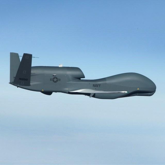 aircraft inflight against blue sky