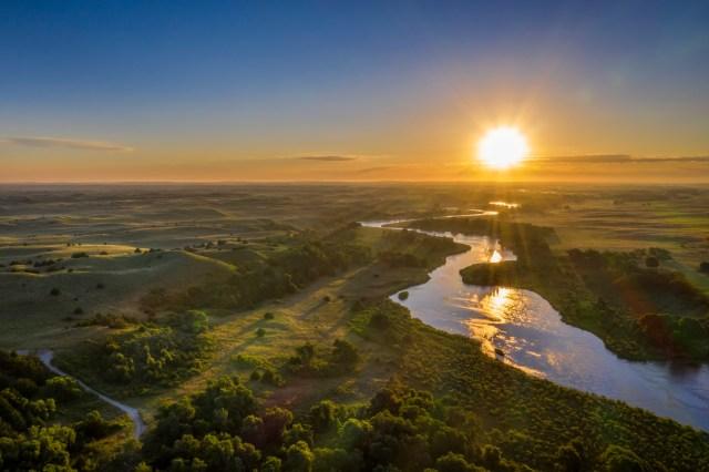 Sunrise over river in Nebraska