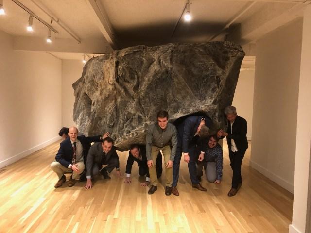 Group of Northrop Grumman Employees in front of rock in Colorado museum