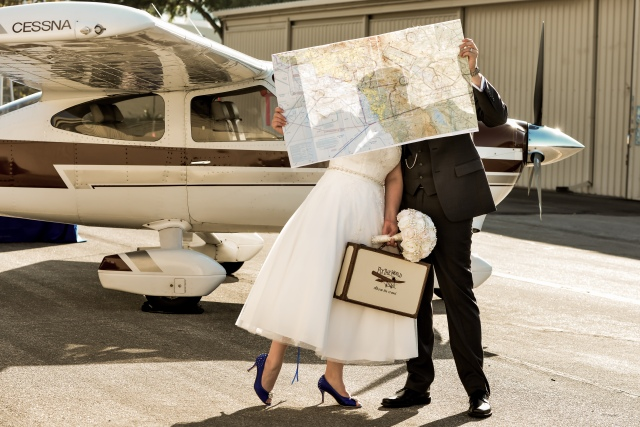 couple wedding photo in front of airplane