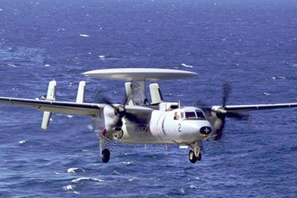 Military propeller aircraft at sea