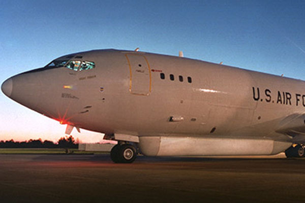 Military aircraft on tarmac at twilight