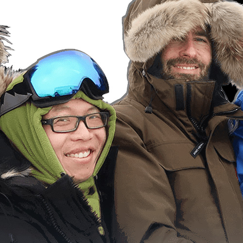 two people smiling in cold weather gear