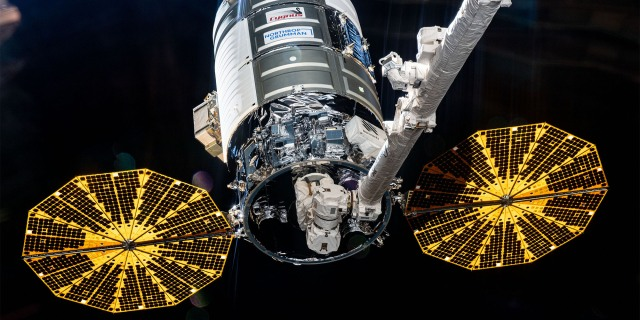 A spacecraft docked to the international space station