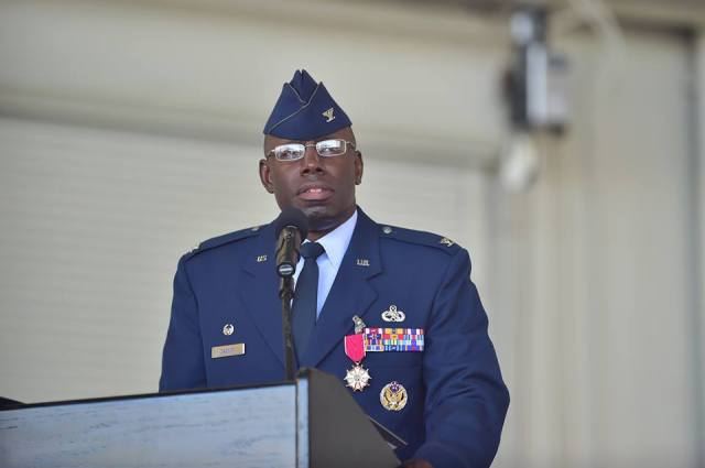 Black man in Army uniform speaks at podium