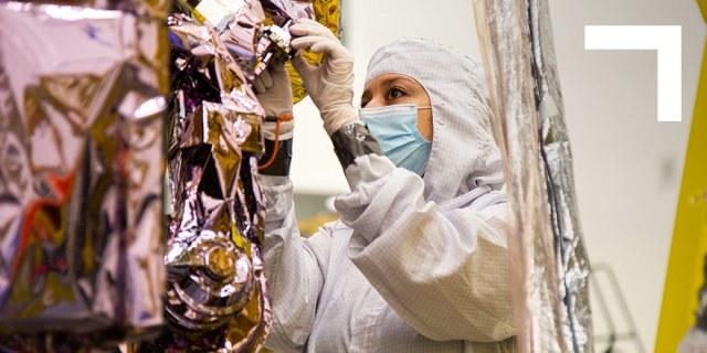 Female engineer working on spacecraft