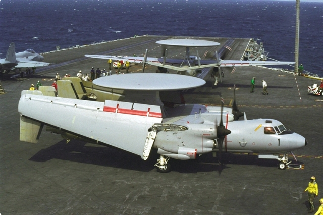 aircraft with wings folded on aircraft carrier