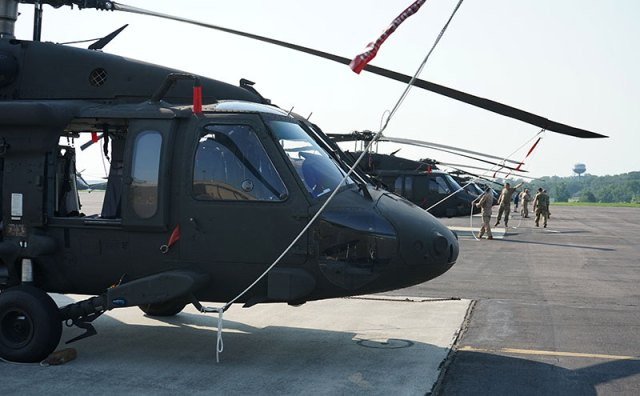 black hawk helicopter on land with blades secured