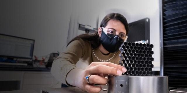 woman working on 3D printer