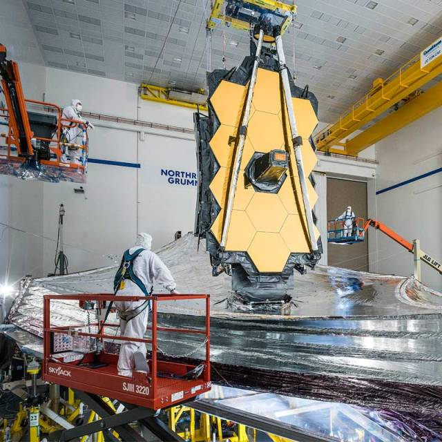 Men working on the James Webb Space Telescope in High Bay