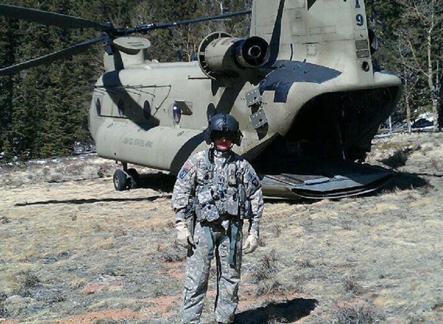 military pilot standing in front of helicopter
