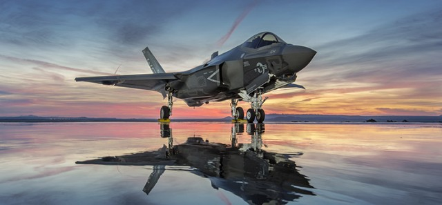 Standing, side-front view of an F-35 at sunset