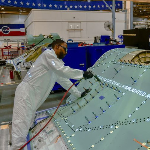 Technician working on a F35 center fuselage