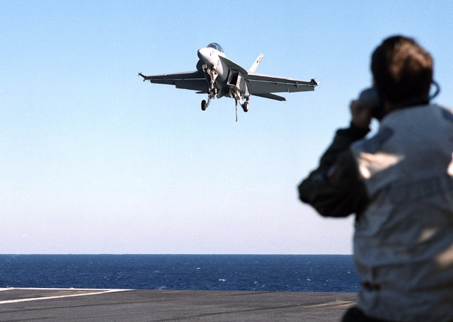 F/A-18 landing on the deck of an aircraft carrier