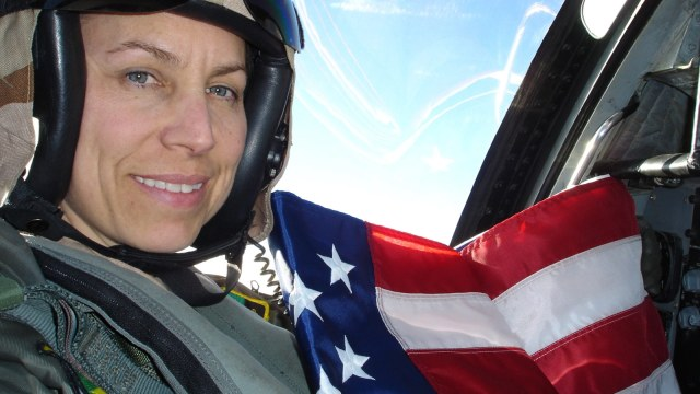 white woman fighter pilot holding flag