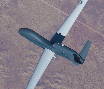 Top view of Global Hawk flying above a terrain