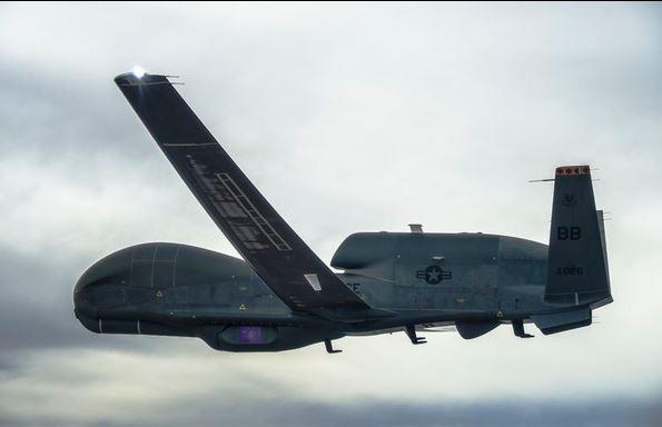 Global Hawk Autonomous aircraft flying in a cloudy sky