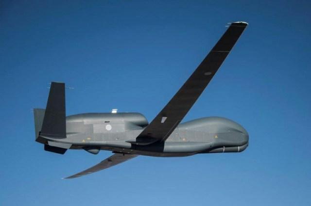 Global Hawk flies against a blue sky