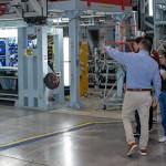 A High School Involvement Partnership (HIP) mentoring program cohort tours a Northrop Grumman facility