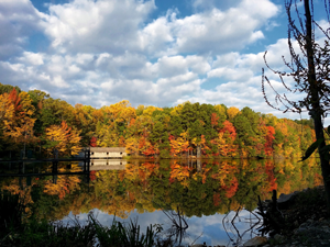 A house reflects on a lake in Huntsville, Alabama