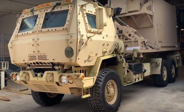 Yellow and tan military vehicle