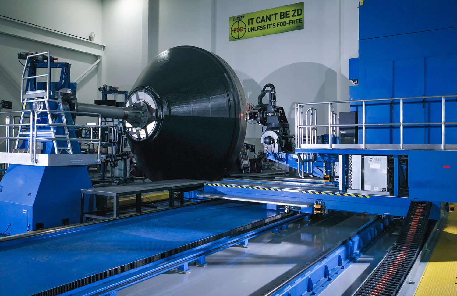 OmegA's payload adapter fitting pathfinder takes shape through automated fiber placement at Northrop Grumman's Iuka, Mississippi facility. (March 2020)