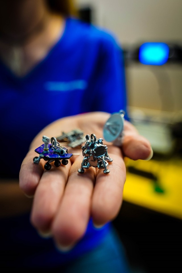 Woman holding 3D printed jewelry in palm