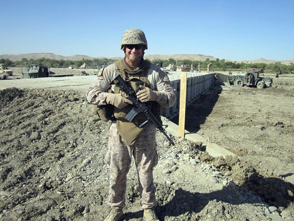 US Marine in uniform holding rifle
