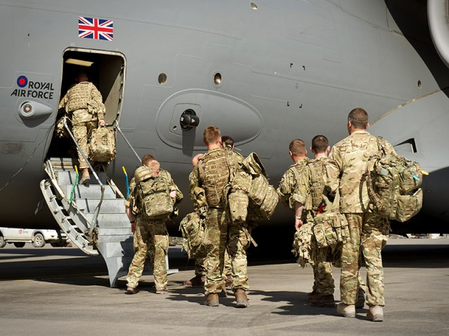 soldiers boarding large military aircraft