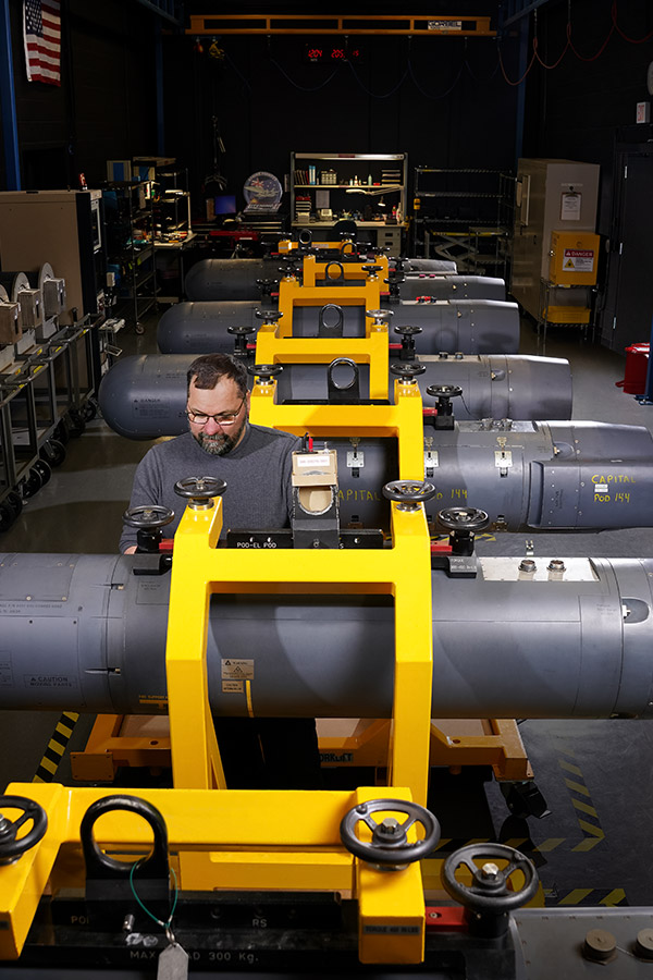 man working on pod assembly line