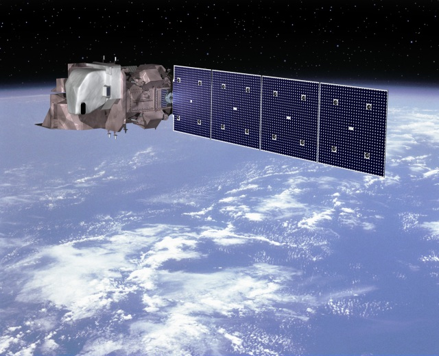 A large satellite in space above Earth's surface