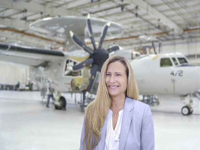 White female in hangar