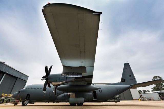 Litening sensor pod hangs from the wing of a C-130J Hercules aircraft