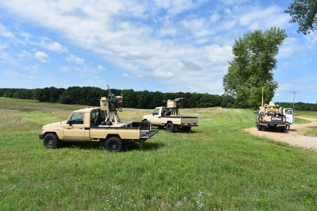 A picture of a vehicle in a green field with the M-ACE capability.