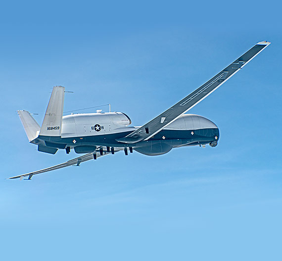 unmanned surveillance plane flying in blue skies