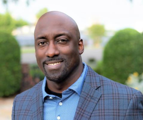 Black male in a blue plaid suit