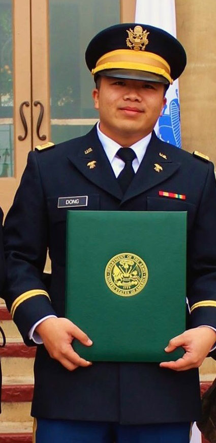 soldier in uniform holding diploma