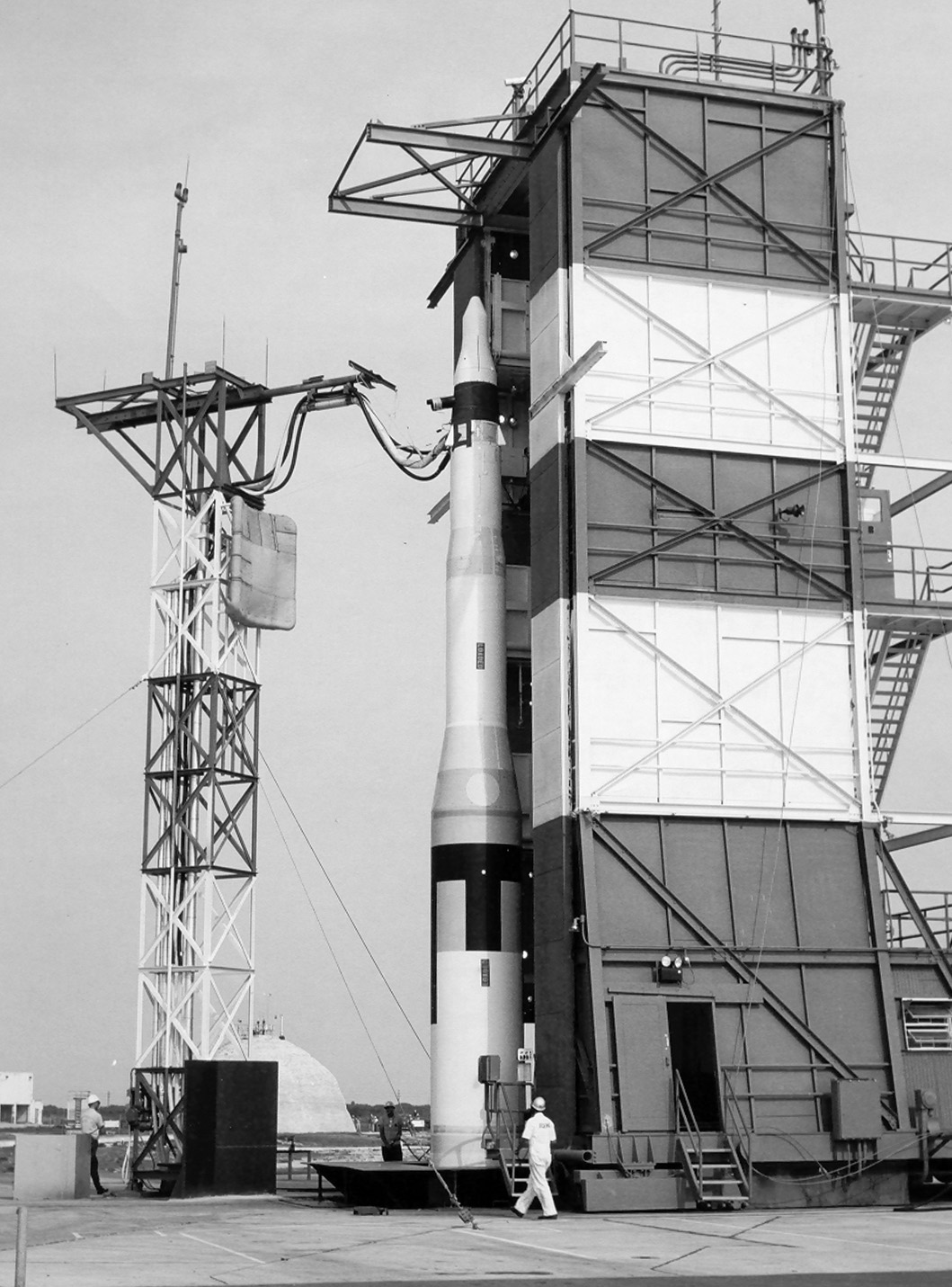 Rocket on launch pad with man in front