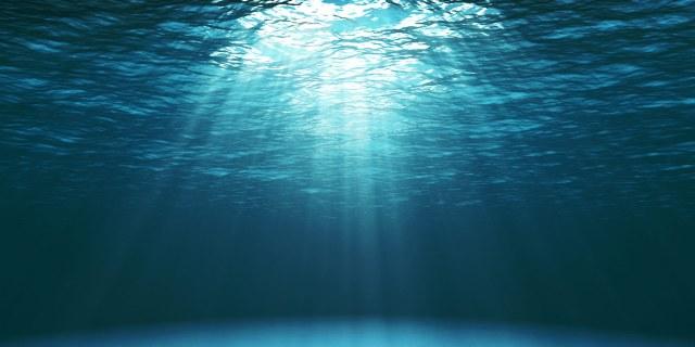 sun rays piercing the ocean